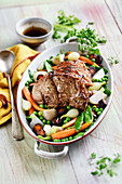 Saddle of lamb roast with spring vegetables
