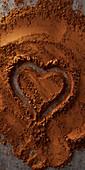 Herz in Kakaopulver gezeichnet