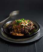 Chopped steak with pepper sauce