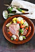 Hotpot mit Gemüse, Fleisch und Champagner