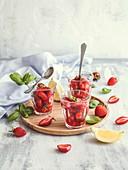 Strawberry fruit salad with basil and lemon