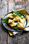Brousse cheese,mint and raisin samossas