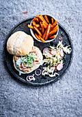 Fish burger, coleslaw salad and sweet potato fries