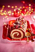 Buche de Noel mit Schokolade und Cranberries