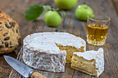 Camembert and a glass of cider