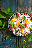 Cauliflower tabbouleh with died apricots,tomatoes and cucumber