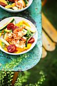Shrimps with chorizo, zucchini and mangoes