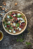 Whole-wheat salad with blue, walnut and cherries