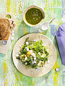 Salad with poached eggs and hemp pesto
