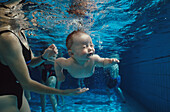Diving baby in pool