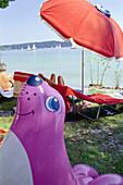 Bathing at Bavarian lake, Rubber toy, Starnberger See, Bavaria, Germany
