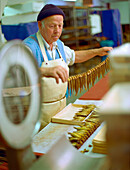 Man preparing Kieler Sprotten speciality, Smokehouse Foeh, Kappel, Schleswig-Holstein, Germany