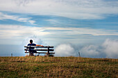 Man sitting on a bench, Belchen, Black Forest, Baden-Wuerttemberg, Germany