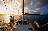 People on a sailing boat at sunset, Iles des Saintes, Guadeloupe Caribbean, America, Caribbean, America