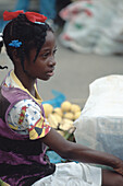 Youngster sitting on market in Castries, St. Lucia, Caribbean