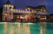 Illuminated hotel and pool at night, Sandals Halcyon Beach Resort, St. Lucia, Caribbean, America