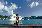 Young couple in front of cruise ship AIDA at harbour of St. George´s, Grenada, Caribbean, America