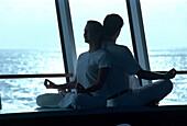 Couple doing Yoga, Cruise ship AIDA, Caribbean, America