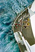 Young couple sunbathing, Cruise ship Aida, Caribbean, America