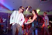 People dancing at a disco at cruise ship Aida, Caribbean, America