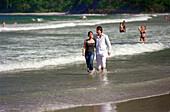 Young couple walking at Maracas Bay, Trinidad, Caribbean