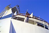 Young couple standing at railing of cruise ship AIDA, Caribbean, America