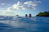 Young couple swimming in the ocean, St. Lucia, Caribbean, America