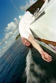 Young man head over the ocean, near Anse Cochon, St. Lucia, Caribbean