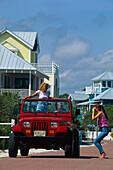 Young people in a jeep, Santa Rosa Island Florida, USA