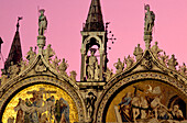Statues and mosaic at St. Marc's basilica in the afterglow, Venice, Italy, Europe