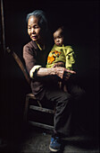 Old chinese woman with child, Yangtsekiang Island, Fengdu, China