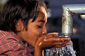 Child drinking water, Rajasthan, India, Asia