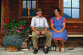 Local married couple before their farmhouse, Bavaria, Germany