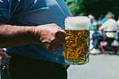 Man carrying one liter of beer, Bavaria, Germany