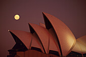 Full moon above the Opera House in the evening, Sydney, New South Wales, Australia