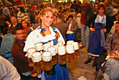 Waitress with full beer stones, Oktoberfest, Munich, Bavaria