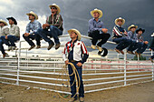 Group of men wearing cowboy clothes, western clothing, Cheyenne Frontier Days Rodeo, Wyoming, USA