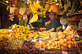 Woman at a market stand with fruit, Bologna, Italy, Europe