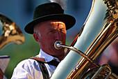 Traditional musician plays tuba, Upper Bavaria, Germany