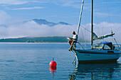 Sail boat on Lake Chiemsee, Upper Bavaria, Germany