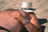 Corpulent man at beach, Mallorca, Baleares, Spain