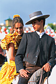 Couple in traditional costumes on a horse, Feria de Abril, Sevilla, Andalusia, Spain, Europe