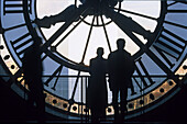 Couple in front of the clock at the Musée d´Orsay, architecture firm Architekturbüro ACT-Architecture, Paris, France