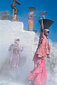 Women carrying heavy loads in the stone quarry, Bihar, India