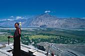 Monks and the Lamaist Monastery above Nubra valley, Ladakh, India