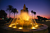 Torre del Oro at night, Gold tower, a military watchtower, Paeso de Christobal, Colon, Seville, Andalusia, Spain