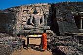 Young monk in front of rock temple Gal Vihara, Polonnaruwa, Sri Lanka, Asia