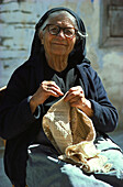 Senior woman doing handiwork, Lefkara, Cyprus