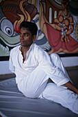 Young man doing Yoga, Sri Lanka, Asia