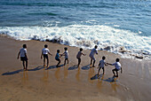 Kids playing on the beach, Ocean Drive, Colombo, Sri Lanka